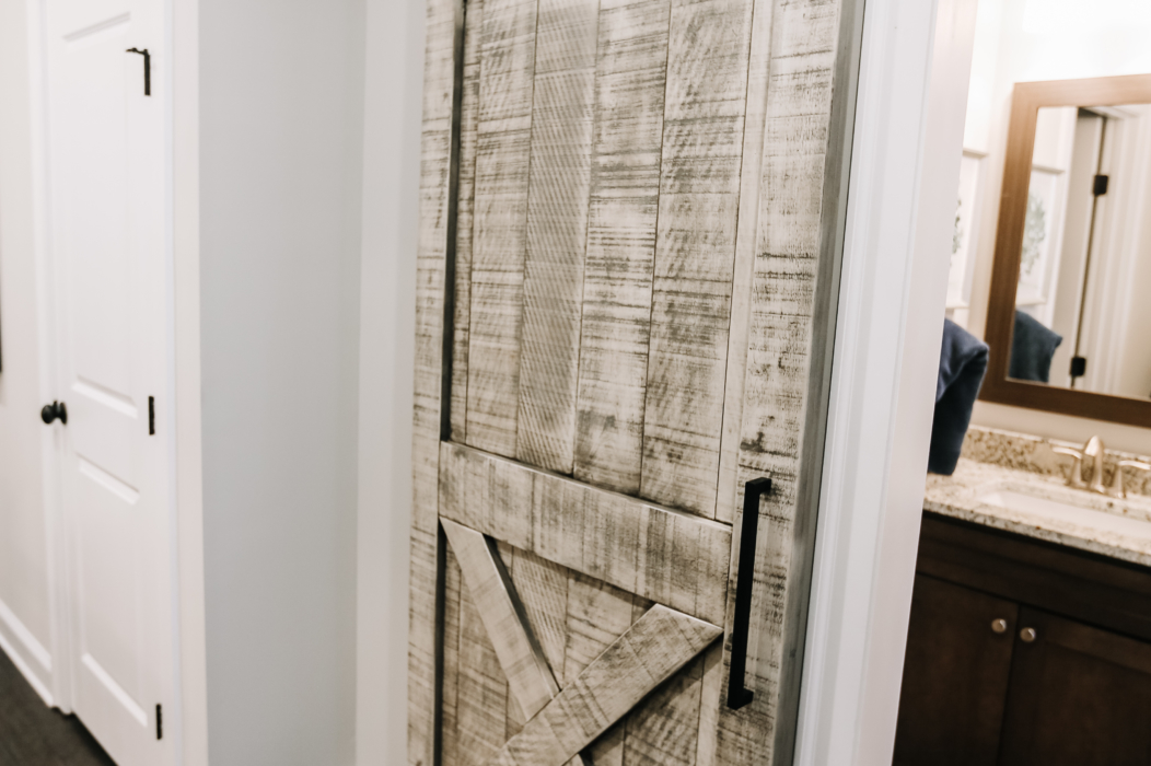 rustic cream barn door for bathroom