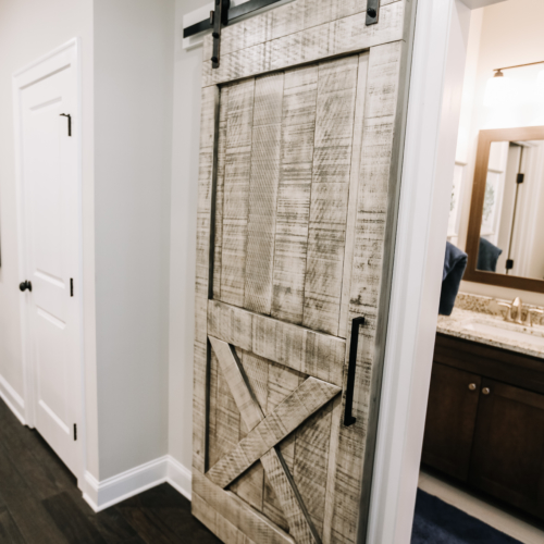 rustic cream barn door for bathroom